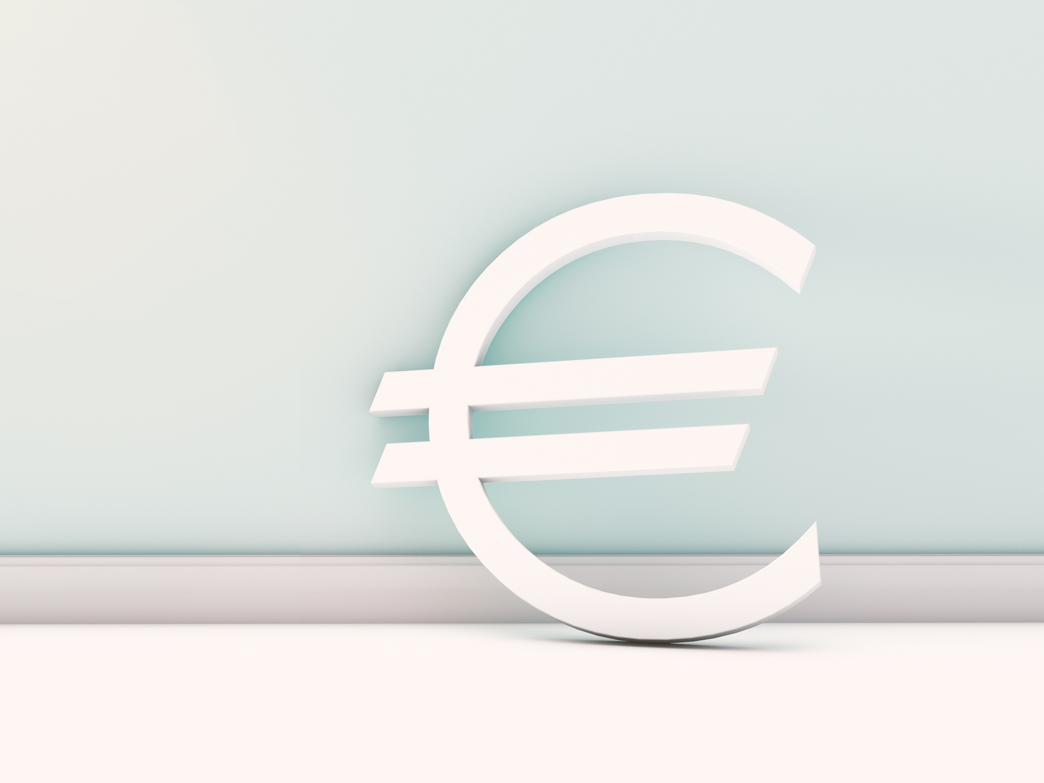 european euro currency symbol standing at empty wall – ready for copy space